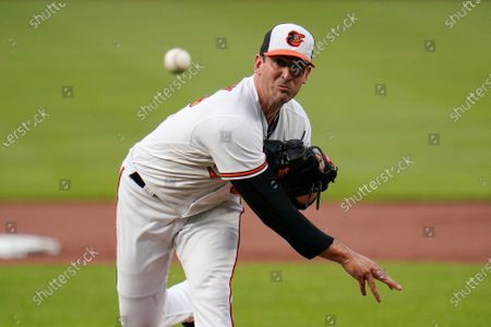 Baltimore Orioles starting pitcher Matt Harvey throws a pitch to the Toronto Blue Jays during the first inning of a baseball game, in Baltimore