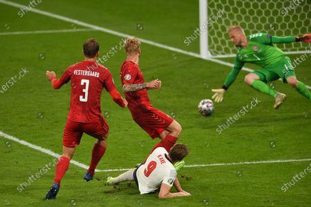 "Stock Image of Harry Kane (England)Jannik Vestergaard (Denmark)Simon Kjaer (Denmark)Kasper Schmeichel (Denmark)                     during the Uefa  ""European Championship 2020 Semifinals  match between England 2-1 Denmark at Wembley Stadium in London, England."