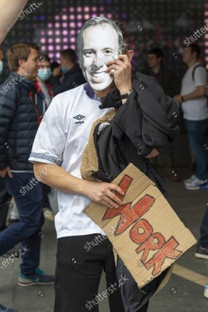 An England fan with a mask of Matt Hancock arrives at Wembley Stadium ahead of the England v Denmark UEFA Euro 2020 semi-final.