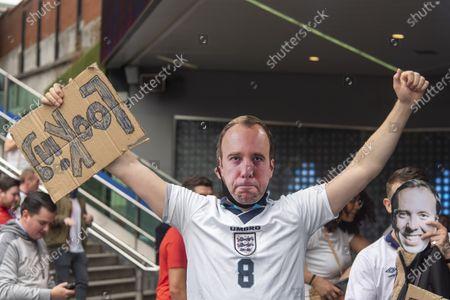 Editorial photo of Fans arrive at Wembley Stadium ahead of the England v Denmark UEFA Euro 2020 semi-final in London, uk -07 Jul 2021