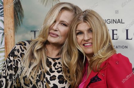"""Jennifer Coolidge, left, and Connie Britton, cast members in """"The White Lotus,"""" pose together at the premiere of the HBO limited series, at the Bel Air Bay Club in Los Angeles"""