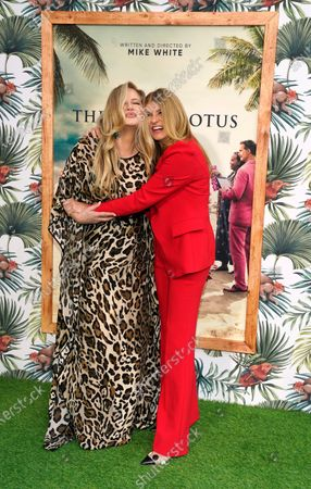 """Stock Photo of Jennifer Coolidge, left, and Connie Britton, cast members in """"The White Lotus,"""" pose together at the premiere of the HBO limited series, at the Bel Air Bay Club in Los Angeles"""