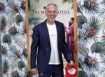 """Mike White, writer/director of """"The White Lotus,"""" poses at the premiere of the HBO limited series, at the Bel Air Bay Club in Los Angeles"""