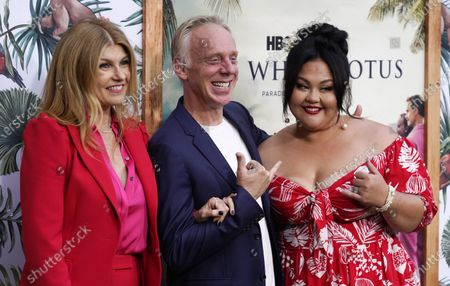 """Mike White, center, writer/director of """"The White Lotus,"""" poses with cast members Connie Britton, left, and Jolene Purdy at the premiere of the HBO limited series, at the Bel Air Bay Club in Los Angeles"""