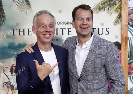 """Mike White, left, writer/director of """"The White Lotus,"""" poses with Casey Bloys, chief content officer of HBO and HBO Max, at the premiere of the HBO limited series, at the Bel Air Bay Club in Los Angeles"""