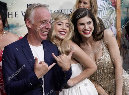 """Mike White, left, writer/director of """"The White Lotus,"""" poses with cast members Sydney Sweeney, center, and Alexandra Daddario at the premiere of the HBO limited series, at the Bel Air Bay Club in Los Angeles"""