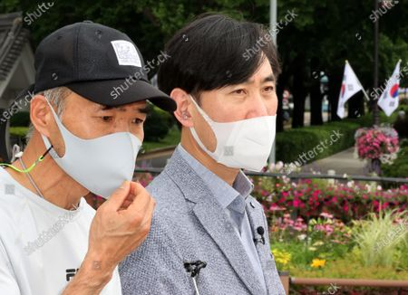 Stock Image of Lee Rae-jin (L), the elder brother of a South Korean official killed by North Korean soldiers while drifting in the North Korean waters in the West Sea in September 2020, calls for President Moon Jae-in to keep his earlier promise to punish those responsible and look into the case immediately near the presidential office in Seoul, South Korea, 08 July 2021. On the right is Rep. Ha Tae-keung of the main opposition People Power Party.