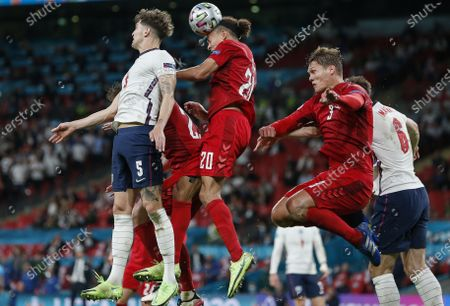 (210708) - LONDON, July 8, 2021 (Xinhua) - England's John Stones (1st L) vies with Denmark's Yussuf Poulsen during the semifinal between England and Denmark at the UEFA EURO 2020 in London, Britain, on July 7, 2021.