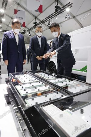Stock Picture of South Korean President Moon Jae-in (L) looks at displays prior to attending a report session on the country's rechargeable battery development strategies at an LG Energy Solution plant in Cheongju, some 140km south of Seoul, South Korea, 08 July 2021.