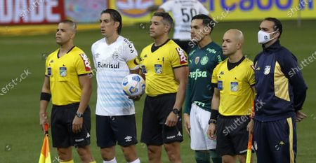 Stock Image of Referee Felipe Fernandes de Lima (MG) with team captains Pedro Geromel and Gustavo Gomez during the Brazilian National League (Campeonato Brasileiro Serie A) football match between Palmeiras v Gremio at the Allianz Parque stadium formerly known as Palestra Italia, in Sao Paulo, SP.