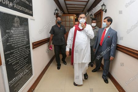 Basil Rohana Rajapaksa (C), arrives to assume duties as Sri Lanka's new Minister of Finance at the ministry office in Colombo, Sri Lanka, 08 July 2021. Basil Rajapaksa, brother of President Gotabaya Rajapaksa and Prime Minister Mahinda Rajapaksa, enters Parliament as the sixth member of the Rajapaksa family in the 9th parliament and the fourth member of the Rajapaksa Brothers. Entered Parliament through the national list system Basil Rajapaksa was sworn in as the new Minister of Finance in Sri Lanka. The Indian Ocean island nation's Powerful Rajapaksa brothers won the landslide victory during the 2020 August parliamentary election and secured the 145 majority seats out of 225 seats in the parliament of Sri Lanka.