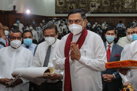 Basil Rohana Rajapaksa (C) assumes duties as Sri Lanka's new Minister of Finance at the ministry office in Colombo, Sri Lanka, 08 July 2021. Basil Rajapaksa, brother of President Gotabaya Rajapaksa and Prime Minister Mahinda Rajapaksa, enters Parliament as the sixth member of the Rajapaksa family in the 9th parliament and the fourth member of the Rajapaksa Brothers. Entered Parliament through the national list system Basil Rajapaksa was sworn in as the new Minister of Finance in Sri Lanka. The Indian Ocean island nation's Powerful Rajapaksa brothers won the landslide victory during the 2020 August parliamentary election and secured the 145 majority seats out of 225 seats in the parliament of Sri Lanka.