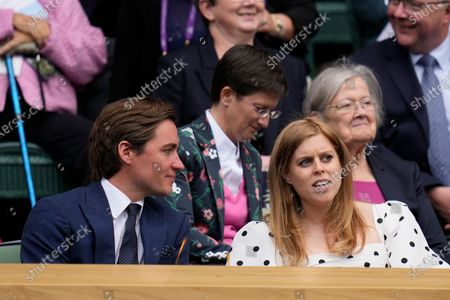 Princess Beatrice and her husband Edoardo Alessandro Mapelli Mozzi attend the women's singles semifinals match between Germany's Angelique Kerber and Australia's Ashleigh Barty on day ten of the Wimbledon Tennis Championships in London