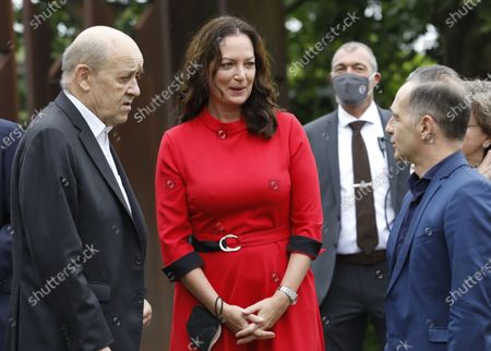 (L-R) French Foreign Minister Jean-Yves Le Drian, German Foreign Minister's partner actress Natalia Woerner and German Foreign Minister Heiko Maas chat near the Monument 'Schengen Agreement', prior to an informal meeting in Schengen, Luxembourg, 08 July 2021. The informal meeting in Schengen will allow the foreign ministers to discuss several topics of common interest.