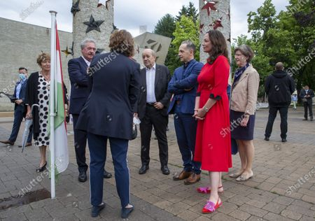 Luxembourg's Foreign Minister Jean Asselborn (3-L), French Foreign Minister Jean-Yves Le Drian (C), German Foreign Minister Heiko Maas (3-R) and partner actress Natalia Woerner (2-L, in red) walk near the Monument 'Schengen Agreement', prior to an informal meeting in Schengen, Luxembourg, 08 July 2021. The informal meeting in Schengen will allow the foreign ministers to discuss several topics of common interest.