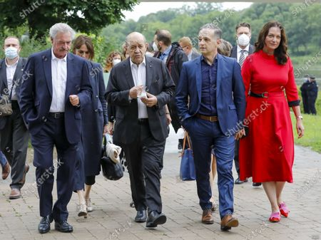 (L-R) Luxembourg's Foreign Minister Jean Asselborn, French Foreign Minister Jean-Yves Le Drian, German Foreign Minister Heiko Maas and partner actress Natalia Woerner walk near the Monument 'Schengen Agreement', prior to an informal meeting in Schengen, Luxembourg, 08 July 2021. The informal meeting in Schengen will allow the foreign ministers to discuss several topics of common interest.