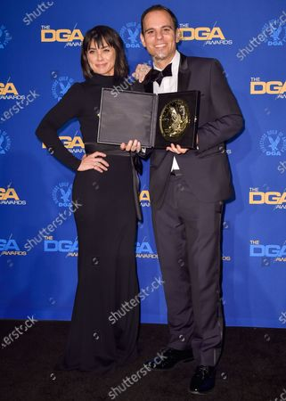 Constance Zimmer and Jason Cohen pose in the press room