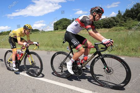 Yellow Jersey Slovenian rider Tadej Pogacar of the UAE-Team Emirates (L) with teammate Portuguese rider Rui Costa (R) in action during the 12th stage of the Tour de France 2021 over 159.4 km from Saint Paul Trois Chateaux to Nimes, France, 08 July 2021.