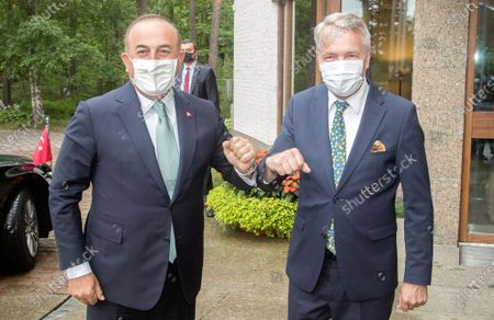 Finnish Foreign Affairs Minister Pekka Haavisto (R) welcomes his Turkish counterpart Mevlut Cavusoglu (L) at Government House in Helsinki, Finland, 08 July 2021. Cavusoglu is on an official visit to Finland.