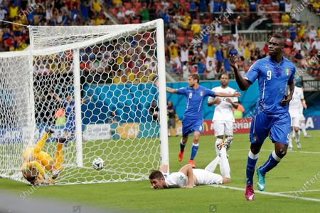 """Italy's Mario Balotelli celebrates after scoring past England's goalkeeper Joe Hart, left, during the group D World Cup soccer match between England and Italy at the Arena da Amazonia in Manaus, Brazil. Pirlo's """"Panenka,"""" Schillaci's Golden Boot clincher and another emotional goal celebration from Marco Tardelli. The major-tournament rivalry between Italy and England has been marked by a few stand-out moments and they all belong to the Italians. England might have home advantage in the Euro 2020 final between the teams at Wembley Stadium on Sunday, July 11, 2021 but Italy has the edge historically"""