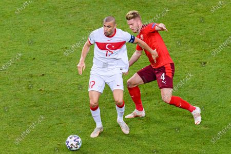 Nico Elvedi of Switzerland (R) chases Burak Yilmaz of Turkey (L) during the UEFA Euro 2020 Championship Group A match between Switzerland and Turkey on June 20, 2021 in Baku, Azerbaijan.