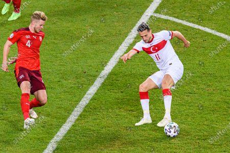 Yusuf Yazici of Turkey(R) in action against Nico Elvedi of Switzerland (L) during the UEFA Euro 2020 Championship Group A match between Switzerland and Turkey on June 20, 2021 in Baku, Azerbaijan.