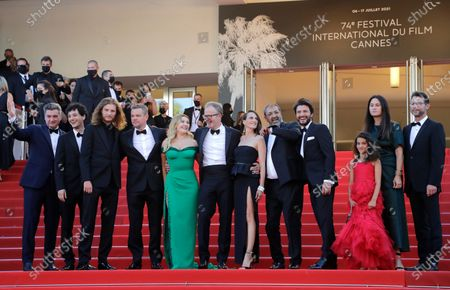 Thomas Bidegain, from left, Noe Debre, Idir Azougli, Matt Damon, Abigail Breslin, director Tom McCarthy, Camille Cottin, Moussa Maaskri, Gregory Di Meglio, Lilou Siauvaud, Liza Chasin and Jonathan King pose for photographers upon arrival at the premiere of the film 'Stillwater' at the 74th international film festival, Cannes, southern France