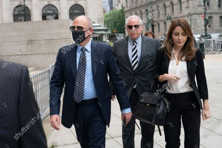 Michael Avenatti, left, arrives for a scheduled sentencing at Manhattan federal court, in New York. The California lawyer who publicly sparred with then-President Donald Trump before criminal fraud charges disrupted his rapid ascent to fame faces sentencing after a jury concluded he tried to extort millions of dollars from Nike
