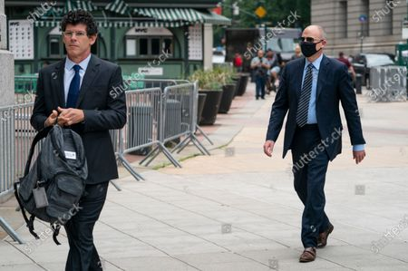 Michael Avenatti, right, arrives for a scheduled sentencing at Manhattan federal court, in New York. The California lawyer who publicly sparred with then-President Donald Trump before criminal fraud charges disrupted his rapid ascent to fame faces sentencing after a jury concluded he tried to extort millions of dollars from Nike