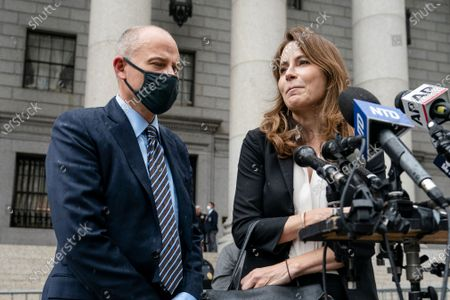 Michael Avenatti, left, stands with his lawyer during a news conference after he departs a scheduled sentencing at Manhattan federal court, in New York. A New York judge has sentenced the combative California lawyer Avenatti to 2 1/2 years in prison for trying to extort up to $25 million from Nike. U.S. District Judge Paul G. Gardephe announced the sentence Thursday in Manhattan, where a jury in early 2020 convicted Avenatti of charges including attempted extortion and fraud