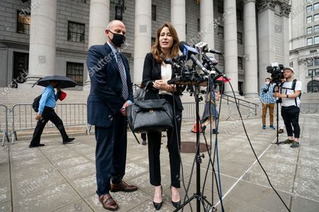 Michael Avenatti, left, stands with his lawyer during a news conference after he departs a scheduled sentencing at Manhattan federal court, in New York. Avenatti was sentenced to 2 1/2 years in prison for trying to extort up to $25 million from Nike by threatening the company with bad publicity