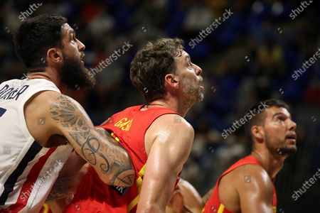 Spain's Pau Gasol (C) and France's Vincent Poirier (L) in action during a friendly basketball match between Spain and France at Martin Carpena pavilion in Malaga, Andalusia, Spain, 08 July 2021. The Spanish team faces France in preparation for the Tokyo 2020 Olympic Games.