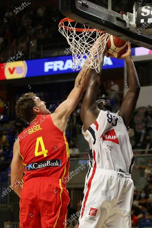 Spain's Pau Gasol (L) tries to block France's Moustapha Fall (R) in action during a friendly basketball match between Spain and France at Martin Carpena pavilion in Malaga, Andalusia, Spain, 08 July 2021. The Spanish team faces France in preparation for the Tokyo 2020 Olympic Games.