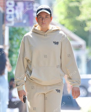 Stock Image of Cameron Hardy was spotted out in West Hollywood as he grabbed an iced coffee at Alfred's . The singer who just hit 1 Million streams of his debut single on Spotify looked cool in a beige sweatsuit from Local Love Club, an athleisure brand from Celebrity Stylist, Maeve Reilly