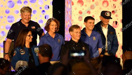 Retired NASA Astronauts (rear l to r) William Shepherd, Sandy Magnus, Rex Walheim and Dr Norm Thagard and (front l to r) Nicole Stott and Chris Ferguson pose for the Public following a celebration marking the tenth anniversary of the final Space Shuttle Mission, STS 135, at the Kennedy Space Center Visitor Center on Thursday, July 8, 2021.