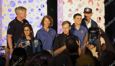 Retired NASA Astronauts (rear l to r) William Shepherd, Sandy Magnus, Rex Walheim and Dr Norm Thagard and (front l to r) Nicole Stott and Chris Ferguson pose for the public during a celebration marking the tenth anniversary of the final Space Shuttle Mission, STS 135, at the Kennedy Space Center Visitor Center on Thursday, July 8, 2021.
