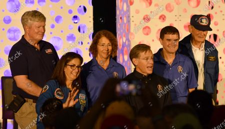 Stock Picture of Retired NASA Astronauts (l to r) William Shepherd, Nicole Stott, Sandy Magnus, Chris Ferguson, Rex Walheim and Dr Norm Thagard pose for the public following a celebration marking the tenth anniversary of the final Space Shuttle Mission, STS 135, at the Kennedy Space Center Visitor Center on Thursday, July 8, 2021.
