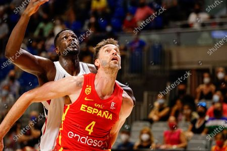 Pau Gasol (r) and Moustapha Fall (l) are seen in action during a friendly basketball match between Spain and France at Palacio de los Deportes Jose Maria Martin Carpena in Malaga.(Final Score; Spain 86:77 France)