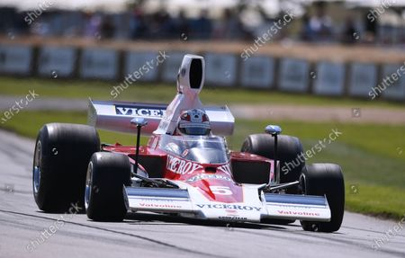 Mario Andretti drives a Lola Chevrolet T332 in the Goodwood Hill Climb; Goodwood House, Chichester, England; Goodwood Festival of Speed; Day Two.