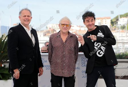 David P. Kelly, from left, Jeremy Thomas and Mark Cousins pose for photographers at the photo call for the film 'The Story of Jeremy Thomas' at the 74th international film festival, Cannes, southern France
