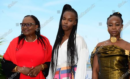 Hadje Fatime Ngoua, Rihane Khalil Alio, Mahamat-Saleh Haroun pose during the photocall for 'Lingui' at the 74th annual Cannes Film Festival, in Cannes, France, 09 July 2021. The movie is presented in the Official Competition of the festival which runs from 06 to 17 July.