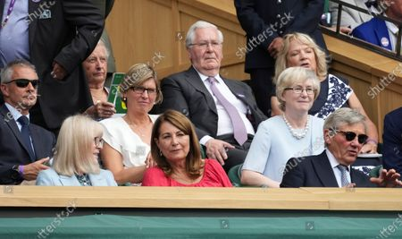 Michael Middleton, right, and Carole, parents of Kate Middleton, wait for the men's singles semifinals match to begin on day eleven of the Wimbledon Tennis Championships in London