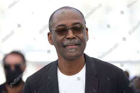 Director Mahamat-Saleh Haroun poses for photographers at the photo call for the film 'Lingui' at the 74th international film festival, Cannes, southern France