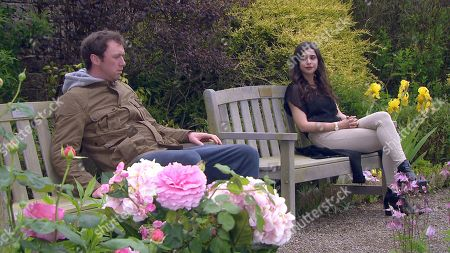 Emmerdale - Ep 9103 Monday 19th July 2021  Meena Jutla, as played by Paige Sandhu, finds a dishevelled Liam Cavanagh, as played by Jonny McPherson, slumped on a bench at the crematorium. As she apologises for his loss, Liam has no idea he's sat by his daughter's killer.