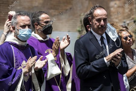 Italian television personality Massimo Lopez (R) looks on at the end of Raffaella Carra's funeral service in the basilica of Santa Maria in Ara Coeli, in Rome, Italy, 09 July 2021. Italian TV icon and entertainment legend Raffaella Carra died on 05 July 2021 at the age of 78.