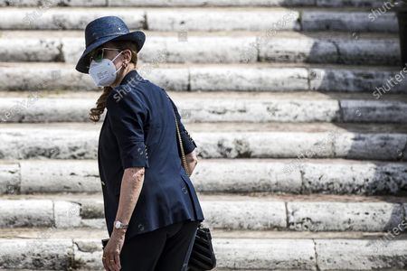 Stock Image of Italian television presenter Milly Carlucci arrives for Raffaella Carra's funeral ceremony at the basilica of Santa Maria in Ara Coeli, in Rome, Italy, 09 July 2021. Italian TV icon and entertainment legend Raffaella Carra died on 05 July 2021 at the age of 78.
