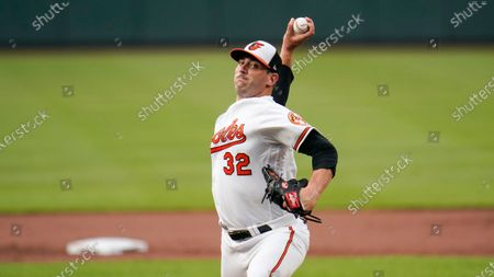 Stock Photo of Baltimore Orioles starting pitcher Matt Harvey throws a pitch to the Toronto Blue Jays during the first inning of a baseball game, in Baltimore