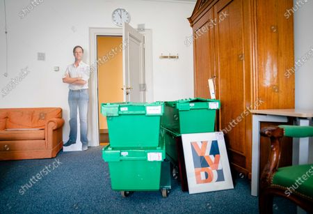 A cardboard cut out picture of  the outgoing Prime Minister Mark Rutte is placed next to boxes of items stacked for relocation in the Dutch House of Representatives in The Hague, The Netherlands, 09 July 2021. During the summer recess, the House of Representatives will temporarily move  the former Ministry of Foreign Affairs, due to a renovation of the Binnenhof.