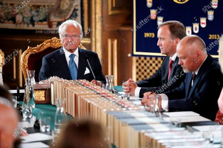 (L-R) Sweden's King Carl Gustaf, Prime Minister Stefan Lofven and Minister of Justice Morgan Johansson during a Change of Government Council at the Royal Palace in Stockholm, Sweden, 09 July 2021. Lofven, who resigned in June after losing a no-confidence vote, got re-elected by parliament on 07 July.