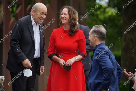 Stock Image of Famous German actress Natalia Woerner wearing red dress joined her friend Heiko Maas at the informal Summit of the Foreign Affairs Ministers of Germany Heiko Maas, France Jean-Yves Le Drian and Luxembourg Jean Asselborn to discuss ongoing european and world topics. 26 september 2021 parliament elections will take place in Germany.